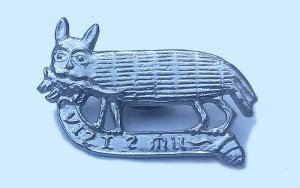 Pewter pin of tabby cat as described in text.