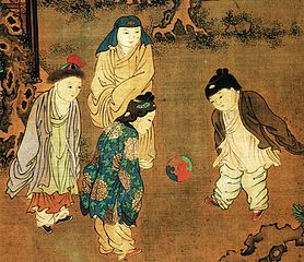 Old Chinese painting of 4 children, in voluminous clothes, kicking a ball around.