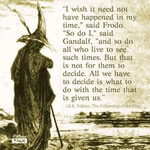 Wizard, with hat and staff, standing next to text of Tolkien quote.